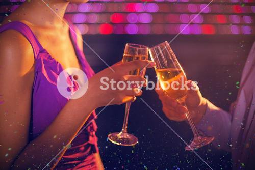 Composite image of couple toasting glass of champagne in bar