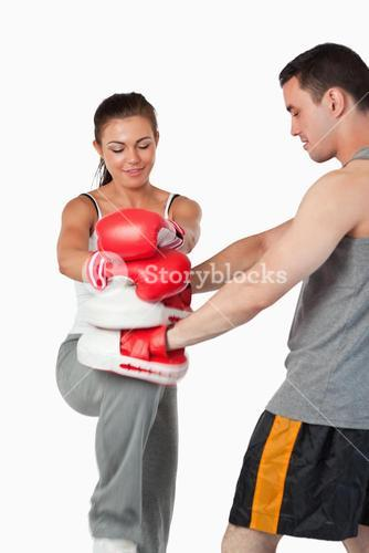Female martial arts fighter practicing her knee technique