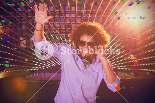 Composite image of male dj playing music