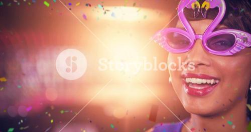 Composite image of woman wearing fancy sunglasses in bar