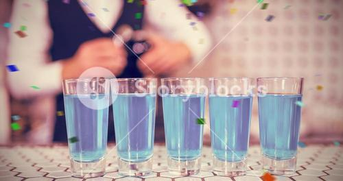 Composite image of glasses of blue lagoon drinks on bar counter