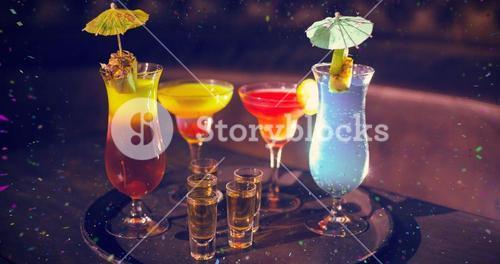 Composite image of various cocktail drinks and shot glasses of tequila on serving tray