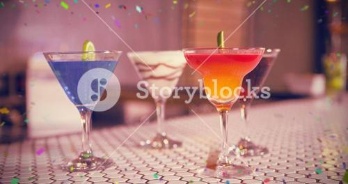 Composite image of various cocktails drinks on bar counter