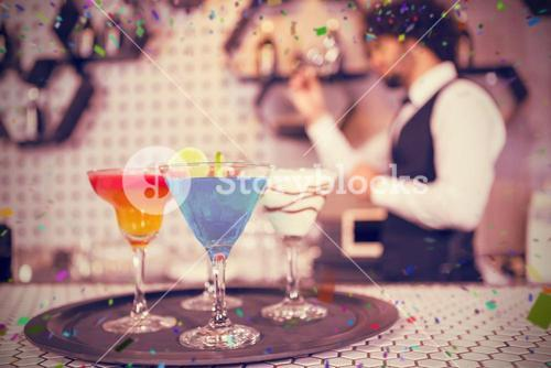 Composite image of various cocktails on serving tray in bar counter