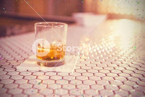Composite image of glass of whisky on bar counter