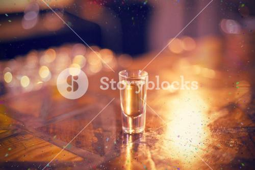 Composite image of tequila shot glass on counter