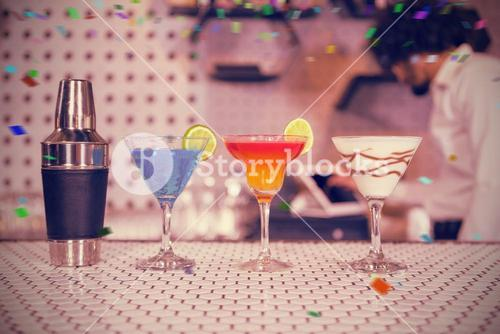 Composite image of various cocktails drinks and shaker on bar counter