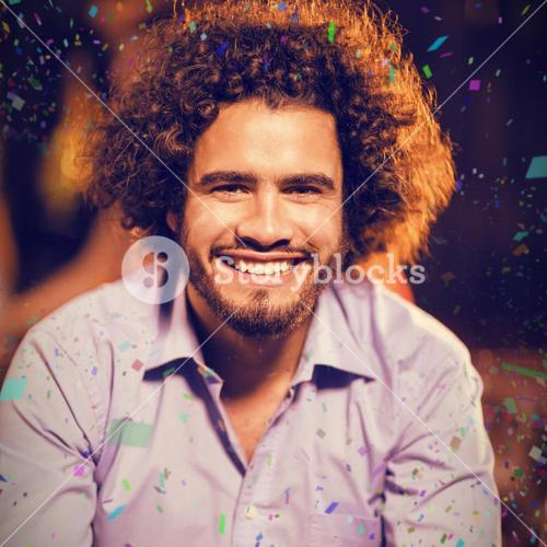 Composite image of smiling man holding glass of whisky in bar