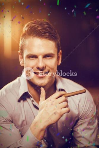 Composite image of smiling man holding a cigar in bar