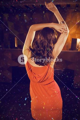 Composite image of young woman dancing on dance floor