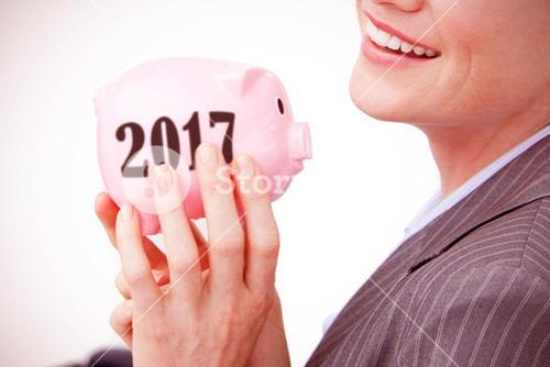 Composite image of cheerful businesswoman holding a piggybank