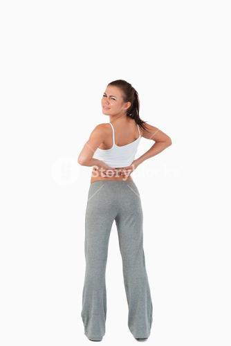 Back view of woman with back pain