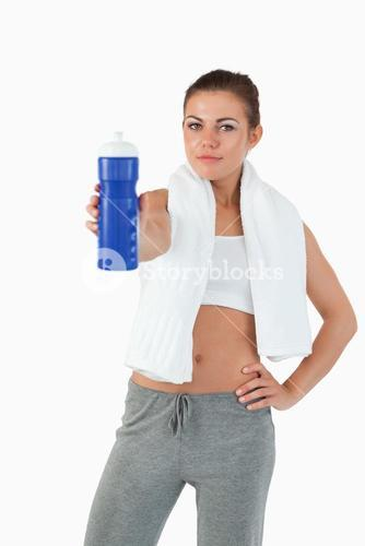 Atletic young woman offering a sip of water