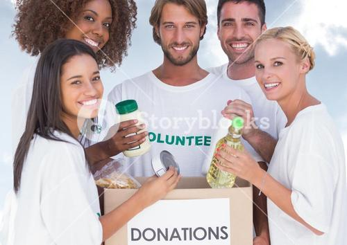 Group of volunteers with donations box
