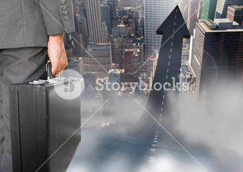 Businessman in city following road