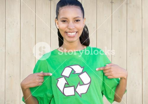 Smiling girl with recycling sign on shirt