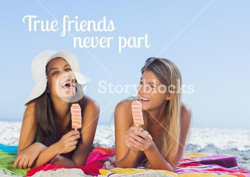 Cheerful pretty women lying on the beach eating ice cream