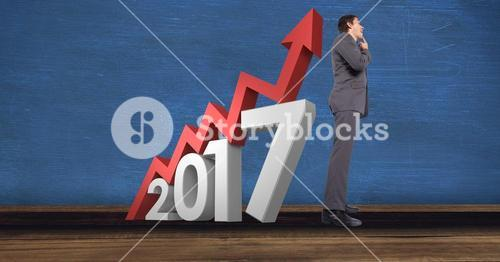 2017 sign and pensive businessman against blue background