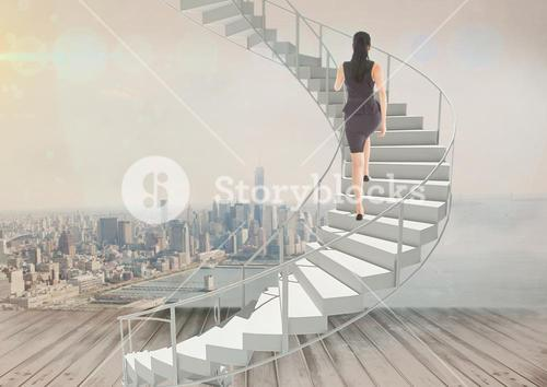 Woman climbing stairs against city background