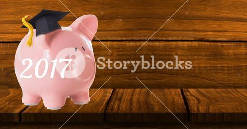 Piggybank on wooden table against wooden background