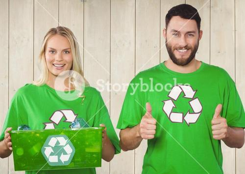 Couple of cheerful volunteer against wooden background