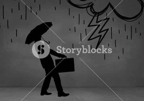 Silhouette of businessman with umbrella against grey background