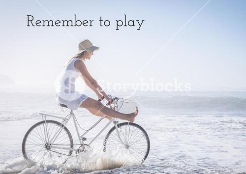 Quote and woman cycling on the beach