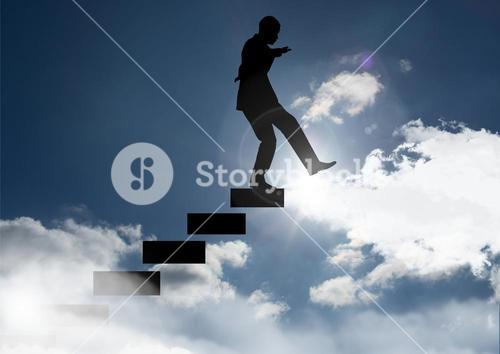 Man climbing stairs against sunset and cloud