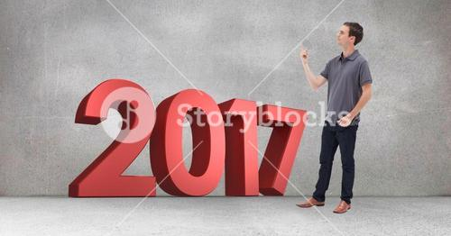 2017 sign and pensive man against grey background
