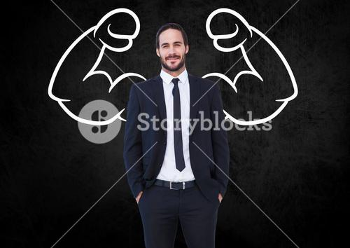 Smiling businessman and drawing against black background