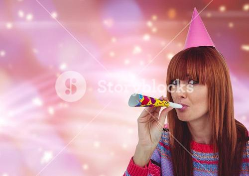 Cheerful woman partying against colorfull background