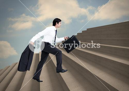 Man climbing stairs against cloudy sky