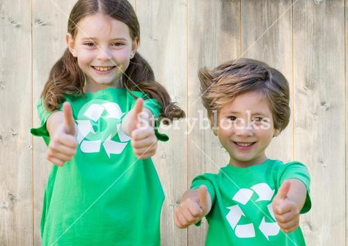 Young volunteer kids thumb up against wooden background