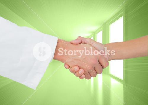 Shaking hands against green background