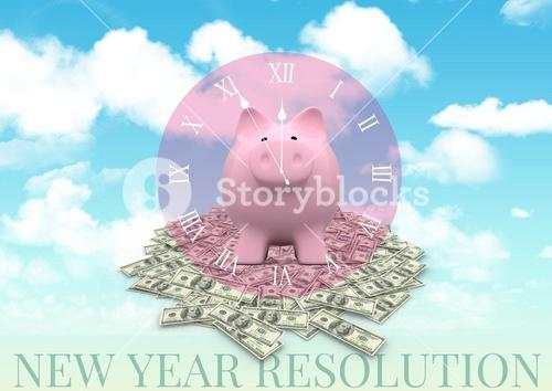 Piggybank on billet against sky background
