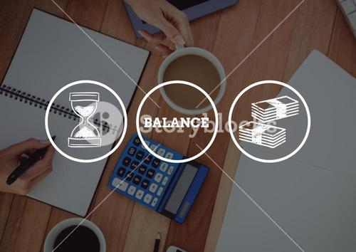 Balance between money and time against desk background