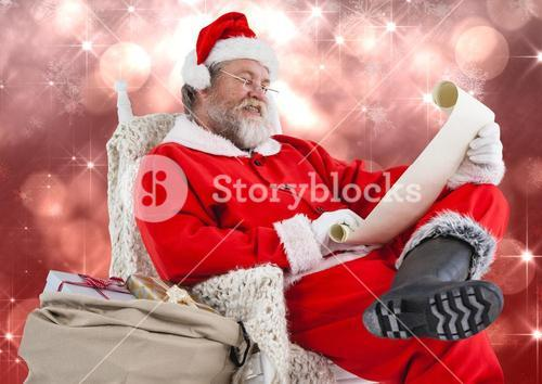 Santa reading letter against blurry red background