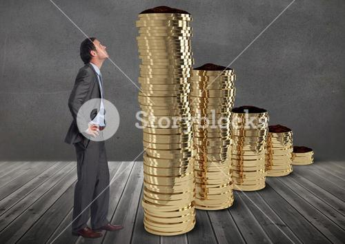 Pensive businessman in front of money against grey background