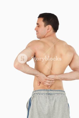 Young male experiencing back pain