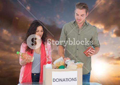 Couple giving donation against sky background