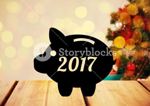 2017 piggybank against blurry christmas background