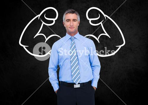 Businessman with drawing against black background