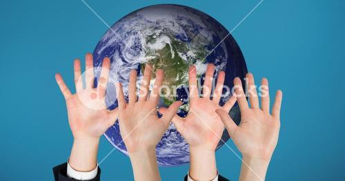 Hands up against earth background