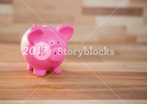 2017 piggybank on wooden floor