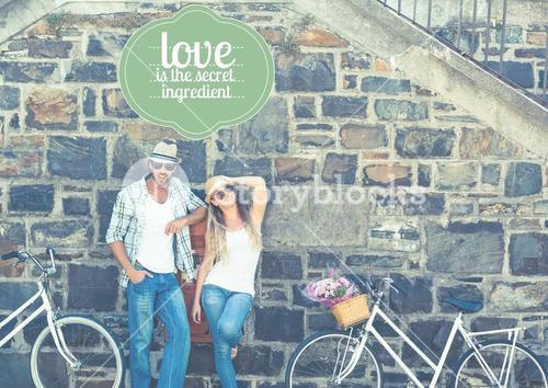 Couple in front of wall with bikes
