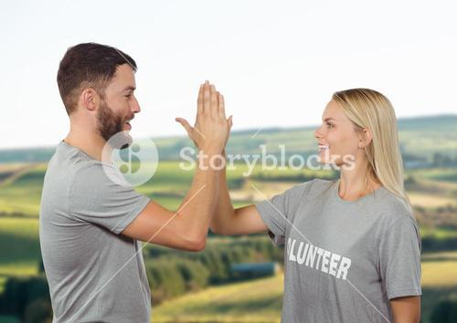 Couple volunteers high five