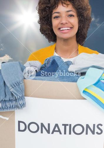 woman smiling with donation box