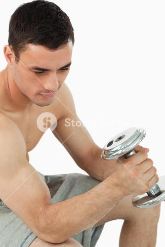 Young male pumping iron