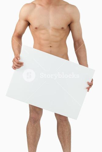 Atletic male body holding banner