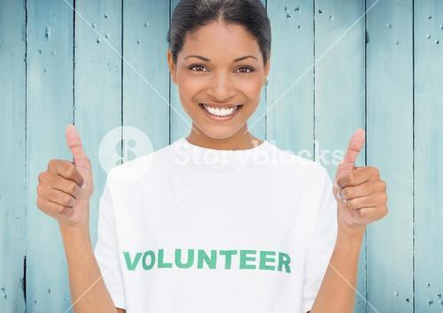 volunteer holding thumbs up